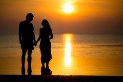 Silhouette of young couple royalty free stock photography