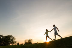 Silhouette of a young couple. Stock Image