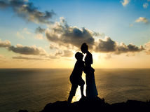 Silhouette of a young couple at sunset Royalty Free Stock Image