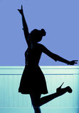 Silhouette of the young dancing woman Royalty Free Stock Photos
