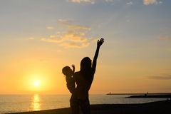 Silhouette of young exciting woman with hand up Royalty Free Stock Images