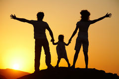 Silhouette of  young family on sunset Royalty Free Stock Photography