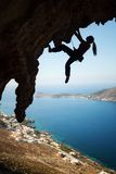 Silhouette of young female rock climber on a cliff. Silhouette of a young female rock climber on a cliff. Kalymnos Island, Greece Royalty Free Stock Images