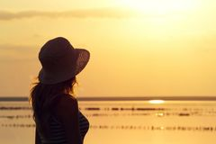 Silhouette of a young girl on the background of the sea Royalty Free Stock Photo