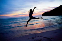Silhouette of young girl jumping in air Royalty Free Stock Photography