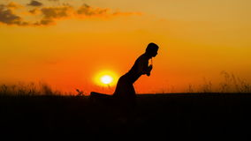 Silhouette of a Young Girl Practicing Yoga  At Royalty Free Stock Image