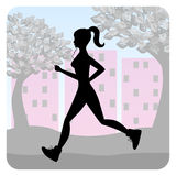 Silhouette of a young girl running in the park Royalty Free Stock Photo