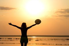 Silhouette of a young girl on the sea in a hat Royalty Free Stock Images