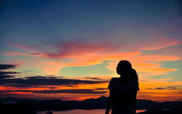Silhouette of young girl when sunset. Silhouette of young girl's side portrait with background of beautiful sunset over ocean. Shot in Coron town, Palawan Royalty Free Stock Image