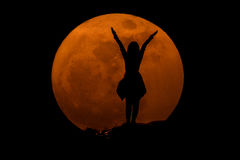 Silhouette of young girl with the super full moon : success concept royalty free stock photos