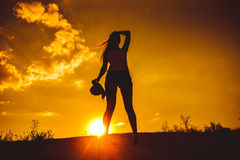 Silhouette of a young girl in a vest and shorts Royalty Free Stock Photos