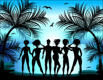 Silhouette of young girls and boys. On the background of a tropical landscape. Summer Trips Royalty Free Stock Photo