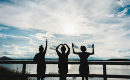 Silhouette of young girls at lake Royalty Free Stock Photo