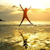 Silhouette of young jumping girl Royalty Free Stock Photography