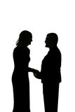 Silhouette of young loving couple holding hands stock photo