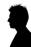 Silhouette of a young man. With funny hair stock images