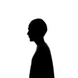 Silhouette of a young man Stock Images