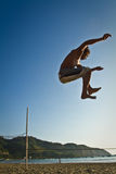Silhouette of young man balancing on slackline at Royalty Free Stock Photography