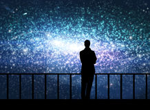 Silhouette of young man in the cosmos Stock Photography