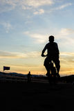 Silhouette of young man  cyclist Royalty Free Stock Photos
