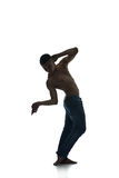 Silhouette of a young man dancer isolated Stock Image
