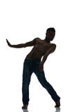 Silhouette of a young man dancer isolated Royalty Free Stock Images