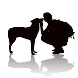 Silhouette of the young man with a dog Stock Photography