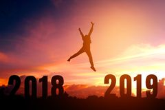 Silhouette young man happy to 2019 new year stock images