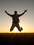 Silhouette of young man jumping high in the air Royalty Free Stock Photo