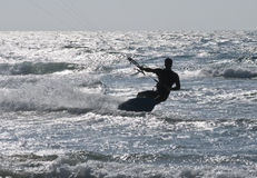 Silhouette of Young Man Kite Boarding in sea Waves Royalty Free Stock Images