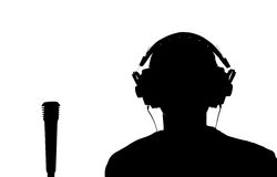 Silhouette of a young man listening to music with headphones Stock Photo