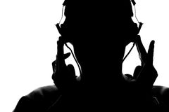 Silhouette of a young man listening to music with headphones Royalty Free Stock Images