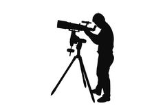 Silhouette of young man looking  through a  telescope Stock Photography