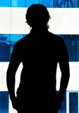 Silhouette of a young man in the office Royalty Free Stock Photography