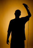 Silhouette of a young man in orange. Silhouette of a young man in orange, darkened at the edges Stock Photos