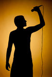 Silhouette of a young man in orange. Royalty Free Stock Photo