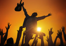 Silhouette of a Young Man Performing in Front of the Crowd Stock Image