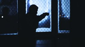 Young man shadow boxing. Silhouette of young man shadow boxing in gym. Male boxer training sparring stock video footage