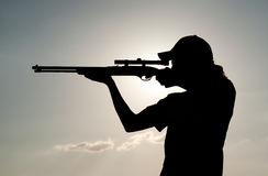 Silhouette of a young man shooting Royalty Free Stock Image