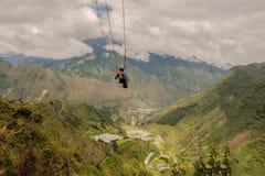 Silhouette Of Young Man On A Swing. Called Flight of the Condor, Banos de Agua Santa, Ecuador Royalty Free Stock Photo