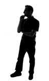 Silhouette of a young man thinking Royalty Free Stock Images