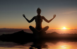 Silhouette of young meditating lady Royalty Free Stock Images