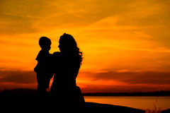 Silhouette of a young mother with her little child Royalty Free Stock Photography