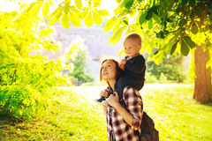 Silhouette of a young mother and her little son at sunset. Beautiful mother and her child in the park at spring time on sunset in Prague, Czech Republic. Family royalty free stock photography