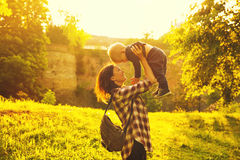 Silhouette of a young mother and her little son at sunset. Beautiful mother and child in the park at spring time on sunset in Prague, Czech Republic. Family royalty free stock images