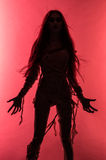 Silhouette of young mummy woman in bandage. On pink background Stock Photography