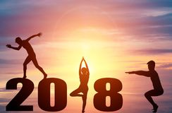 Silhouette young people practicing yoga. On 2018 new year Royalty Free Stock Photo
