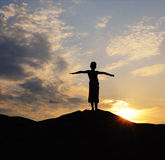Silhouette of young person on mountain Stock Images