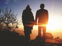 Silhouette of Young Romantic Couple Holding Hands at Amazing Golden Sunset. Carefree Travel Lyfestyle Relationship Royalty Free Stock Images