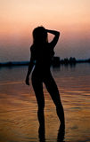 Silhouette of a young sensual woman in a river water Stock Photo